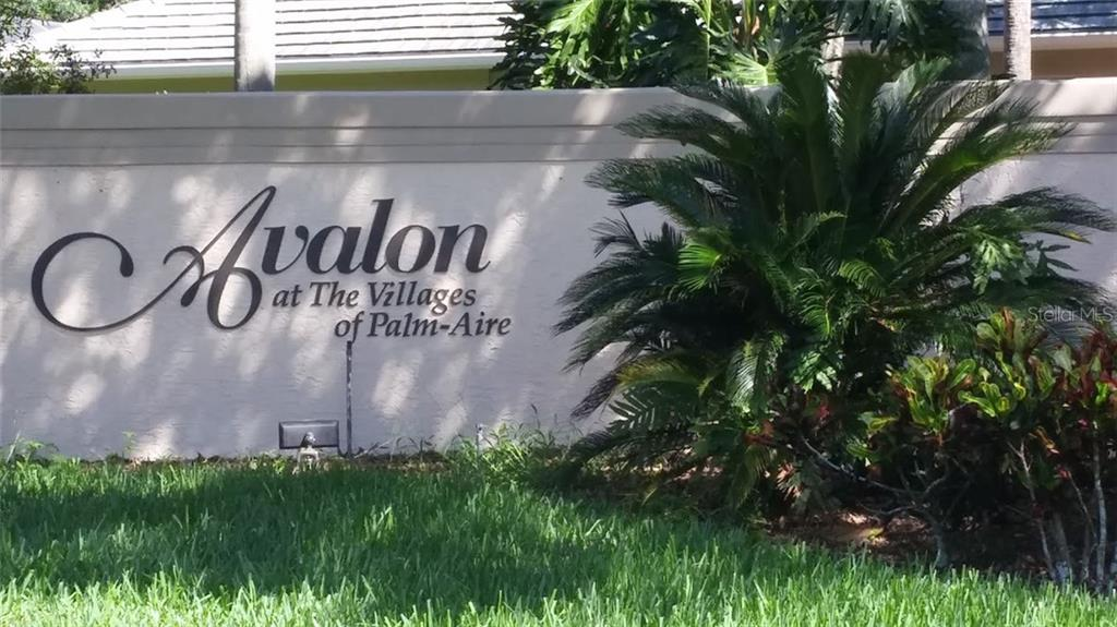 Welcome to Avalon at The Villages of Palm-Aire. Note the impressively landscaped, walled & gated entrance. - Villa for sale at 6953 Mystic Ln, Sarasota, FL 34243 - MLS Number is A4188738