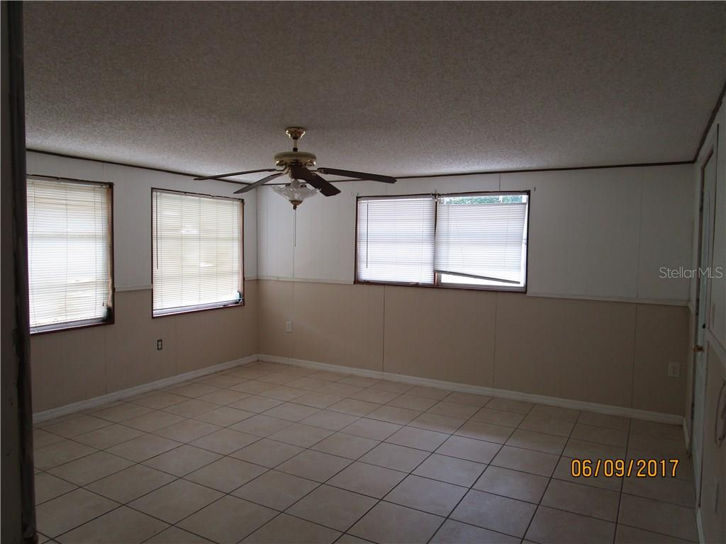 Large 3rd bedroom/living area with own entrance - Single Family Home for sale at 3002 36th Ave W, Bradenton, FL 34205 - MLS Number is A4189280