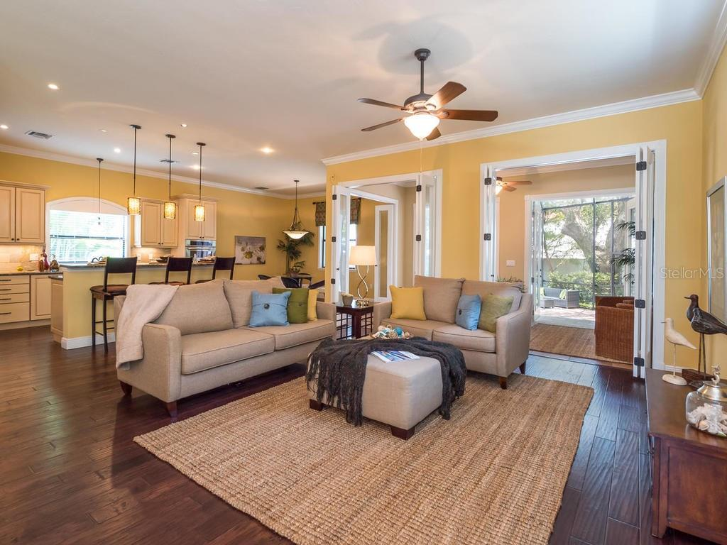 True open floor plan with beautiful wood floors throughout.  Great lighting with lots of natural light. - Single Family Home for sale at 1884 Grove St, Sarasota, FL 34239 - MLS Number is A4189365