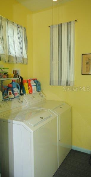 Separate indoor Laundry room with windows for natural light. - Single Family Home for sale at 3319 Mayflower St, Sarasota, FL 34231 - MLS Number is A4189488