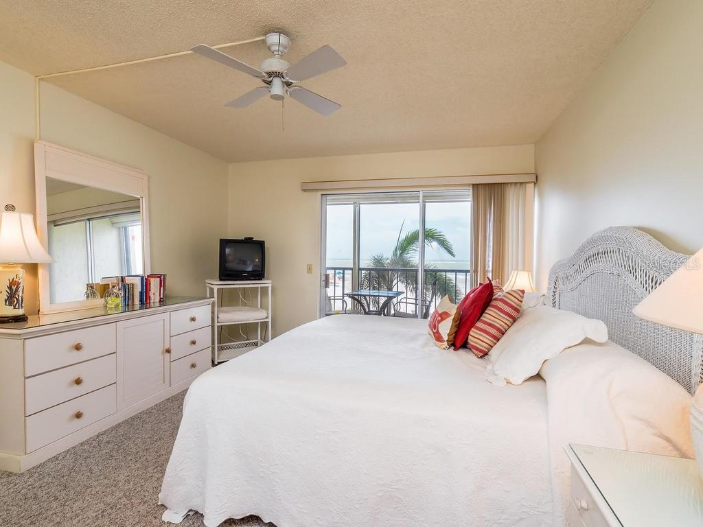 Master bedroom with sliders to screened balcony with Gulf views - Condo for sale at 19 Whispering Sands Dr #205, Sarasota, FL 34242 - MLS Number is A4189914