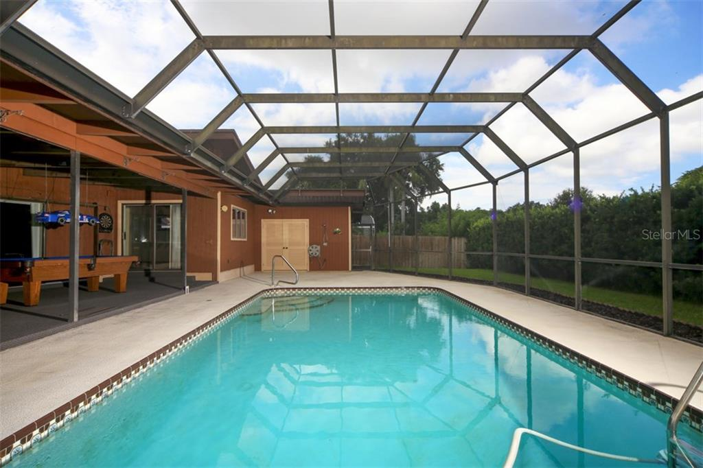Large caged pool with pool 1/2 bath - Single Family Home for sale at 1602 54th St W, Bradenton, FL 34209 - MLS Number is A4191877