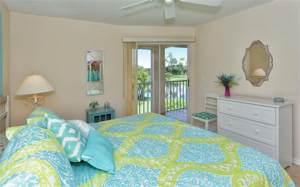 Master bedroom has sliders to the lanai and highlights the wonderful view. - Condo for sale at 9300 Clubside Cir #1201, Sarasota, FL 34238 - MLS Number is A4192821