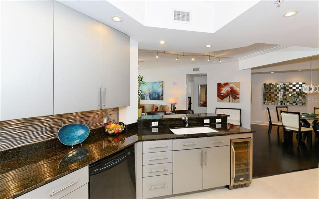 UPDATED KITCHEN WITH WINE REFRIGERATOR - Condo for sale at 100 Central Ave #h716, Sarasota, FL 34236 - MLS Number is A4193586