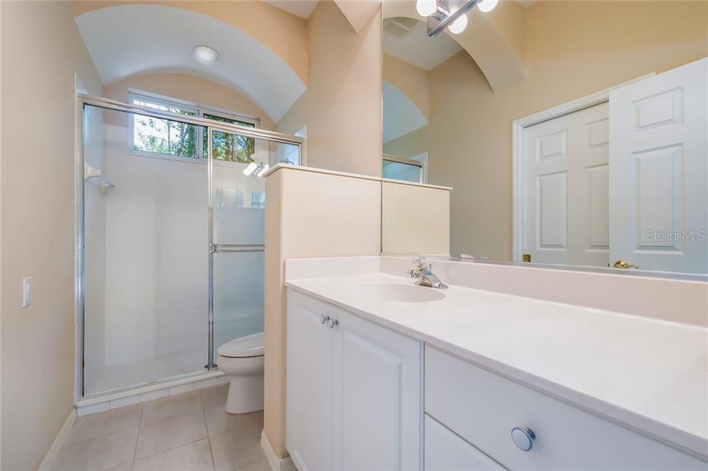 The pool bath. - Single Family Home for sale at 8019 Collingwood Ct, University Park, FL 34201 - MLS Number is A4193802