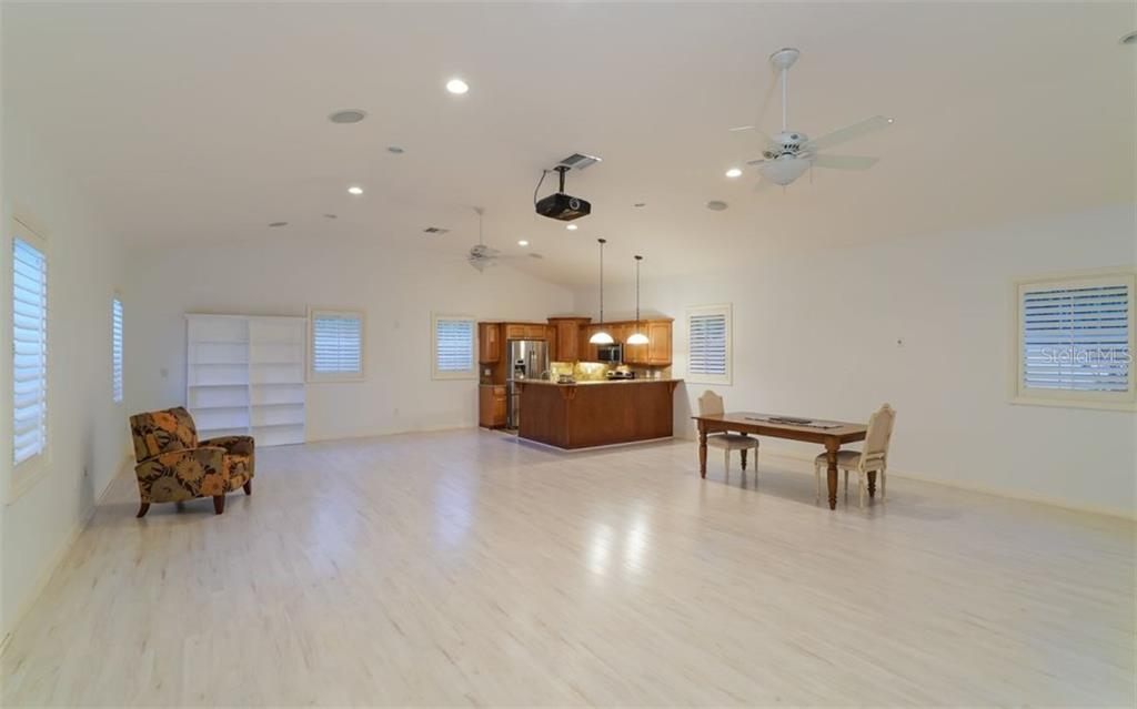 Huge bonus room above 3-car garage with full kitchen and bath.  New flooring installed recently. Only your imagination limits the possible uses for this room; playroom, exercise room, additional sleeping area, or another room with large retractable screen with over-head projector. - Single Family Home for sale at 9818 9th Ave Nw, Bradenton, FL 34209 - MLS Number is A4194125