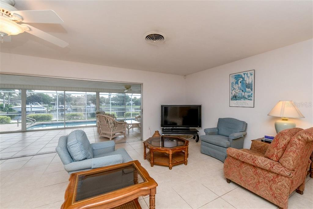 Living room with sliders to lanai - Single Family Home for sale at 5515 Contento Dr, Sarasota, FL 34242 - MLS Number is A4194719