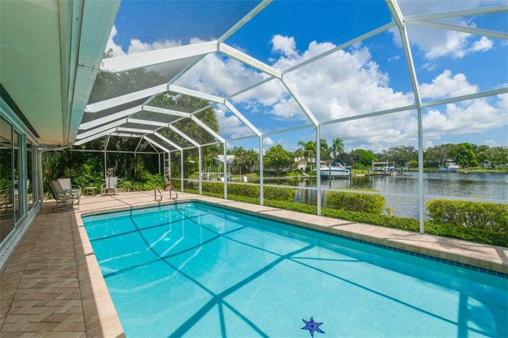 Swimming pool with canal views - Single Family Home for sale at 5515 Contento Dr, Sarasota, FL 34242 - MLS Number is A4194719