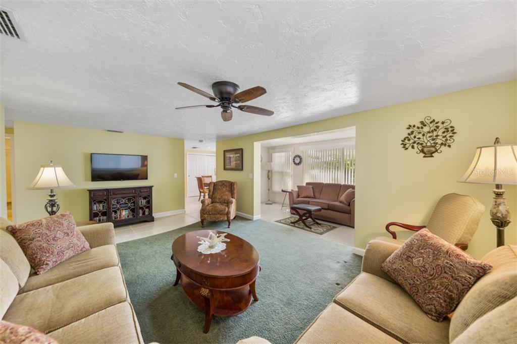 Living room/Lanai - Condo for sale at 6140 Midnight Pass Rd #c-9, Sarasota, FL 34242 - MLS Number is A4195879