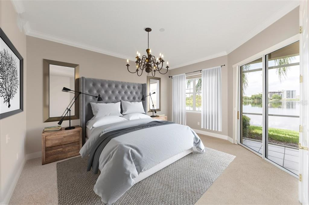 Staged master bedroom with access to lanai and view of the lake. - Condo for sale at 6415 Moorings Point Cir #102, Lakewood Ranch, FL 34202 - MLS Number is A4196054