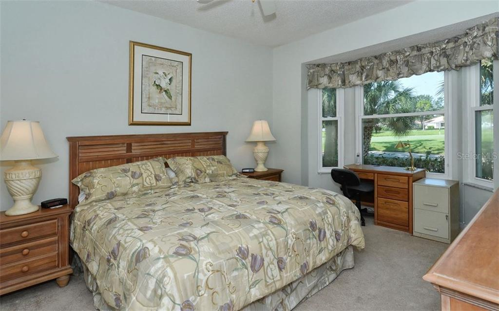 Master bedroom boasts a bay window overlooking the golf course. - Condo for sale at 9570 High Gate Dr #1712, Sarasota, FL 34238 - MLS Number is A4196327