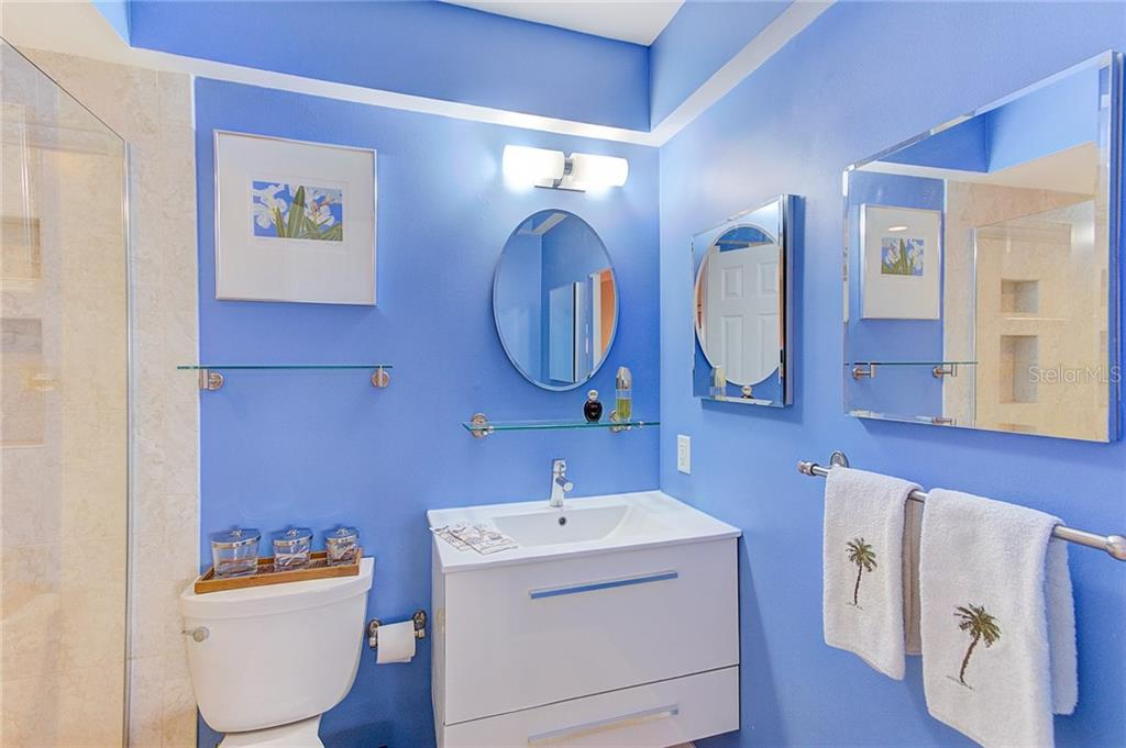 Updated Master Bath with shower bench and designer vanity - Condo for sale at 600 Manatee Ave #236, Holmes Beach, FL 34217 - MLS Number is A4197636