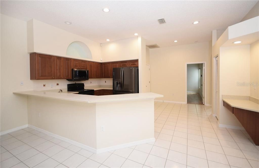 Kitchen and desk area - Single Family Home for sale at 9520 Hawksmoor Ln, Sarasota, FL 34238 - MLS Number is A4197662