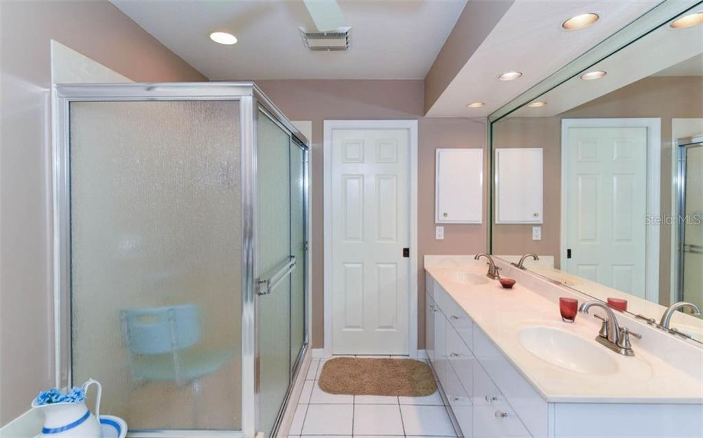 Master Bath Offers Dual Sinks, Jacuzzi Tub, Walk in Shower and Separate Water Closet with Large Linen - Single Family Home for sale at 1632 Valley Dr, Venice, FL 34292 - MLS Number is A4197771