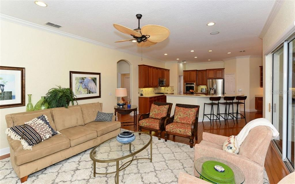 Family room to kitchen - Single Family Home for sale at 9919 Portside Ter, Bradenton, FL 34212 - MLS Number is A4197815
