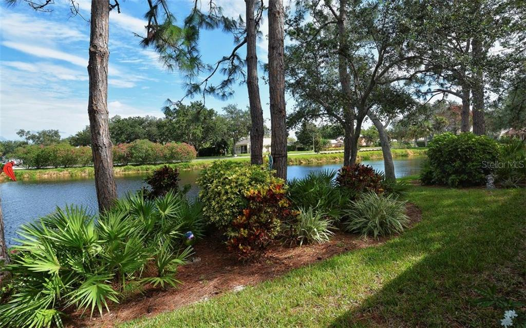 View from the enclosed lanai. - Single Family Home for sale at 9571 Knightsbridge Cir, Sarasota, FL 34238 - MLS Number is A4197972