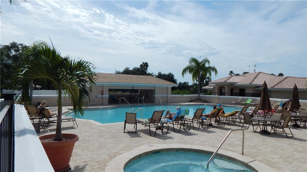Main pool with spa - one of 5 heated community pools - Single Family Home for sale at 4415 Legacy Ct, Sarasota, FL 34241 - MLS Number is A4198107