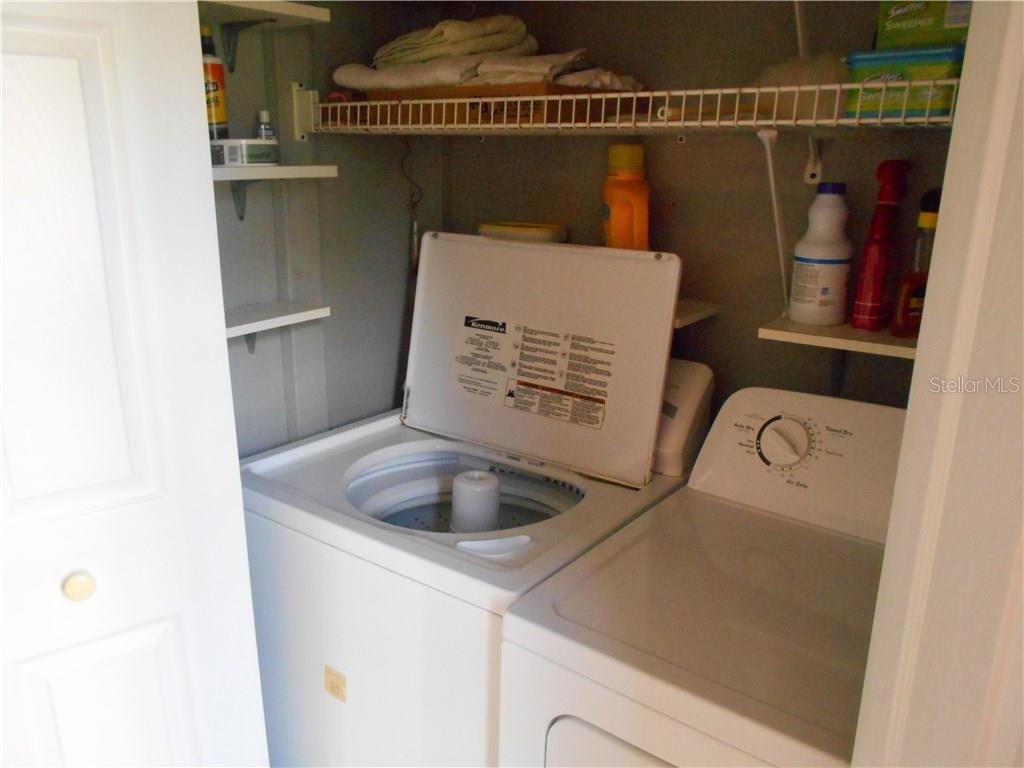 Laundry closet - Condo for sale at 5661 Midnight Pass Rd #403, Sarasota, FL 34242 - MLS Number is A4198451