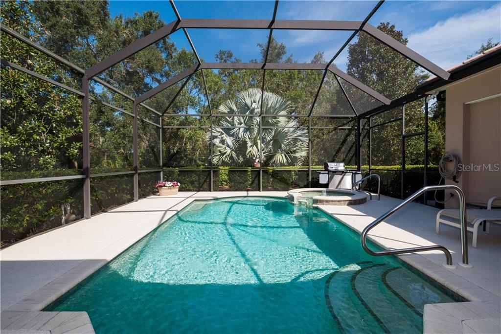 Covered lanai, outdoor kitchen with electric grill. - Single Family Home for sale at 4887 Carrington Cir, Sarasota, FL 34243 - MLS Number is A4199511