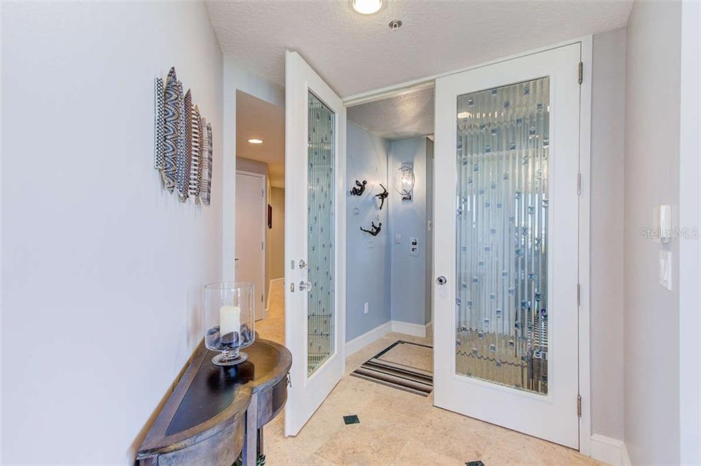 Custom Cut Glass Front Doors - Condo for sale at 3060 Grand Bay Blvd #142, Longboat Key, FL 34228 - MLS Number is A4199568