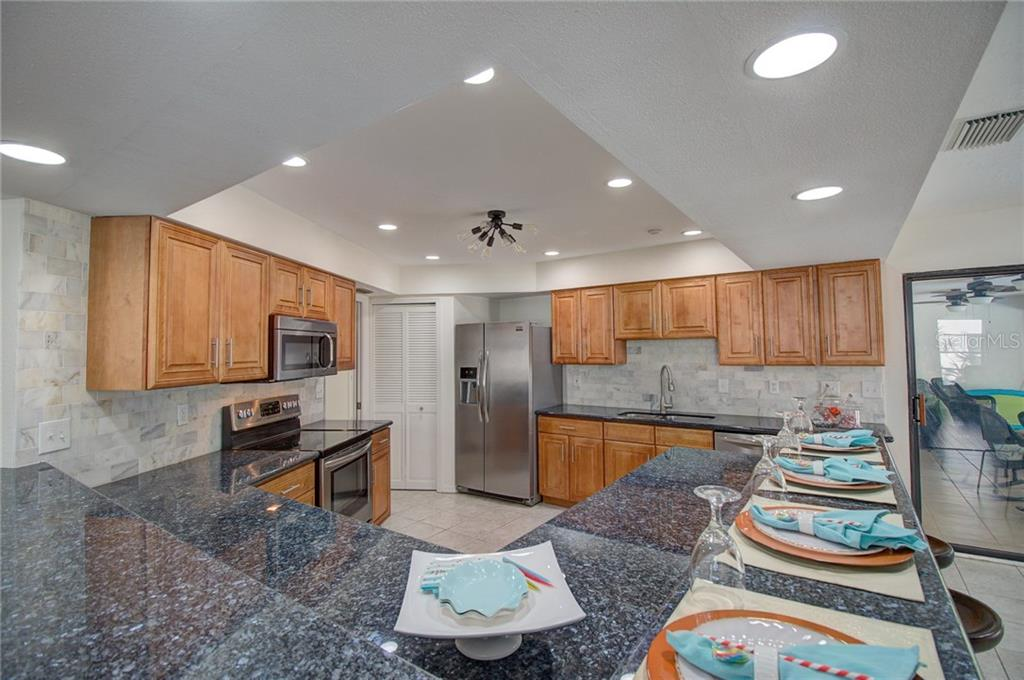 Kitchen, Granit Counters, New Frigidare Gallery Appliances - Single Family Home for sale at 1087 Hoover Cir, Nokomis, FL 34275 - MLS Number is A4201722