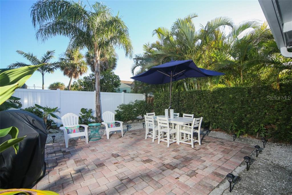 Paved Barbecue area with lush landscaping - Single Family Home for sale at 213 70th St, Holmes Beach, FL 34217 - MLS Number is A4202171