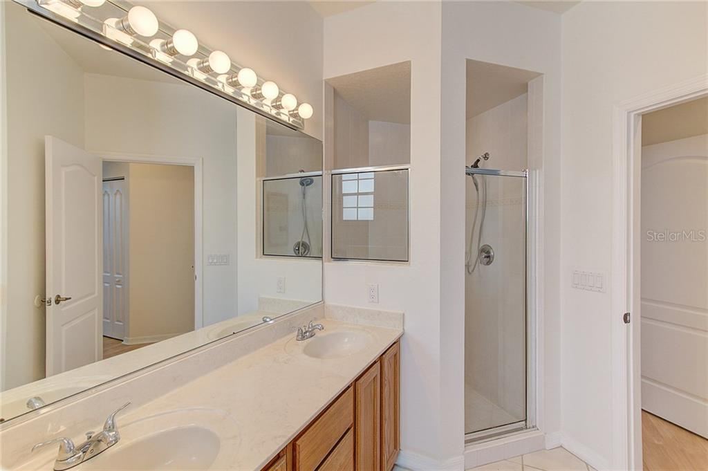 Master Bathroom with view of walk-in shower - Single Family Home for sale at 530 Hunter Ln, Bradenton, FL 34212 - MLS Number is A4203433