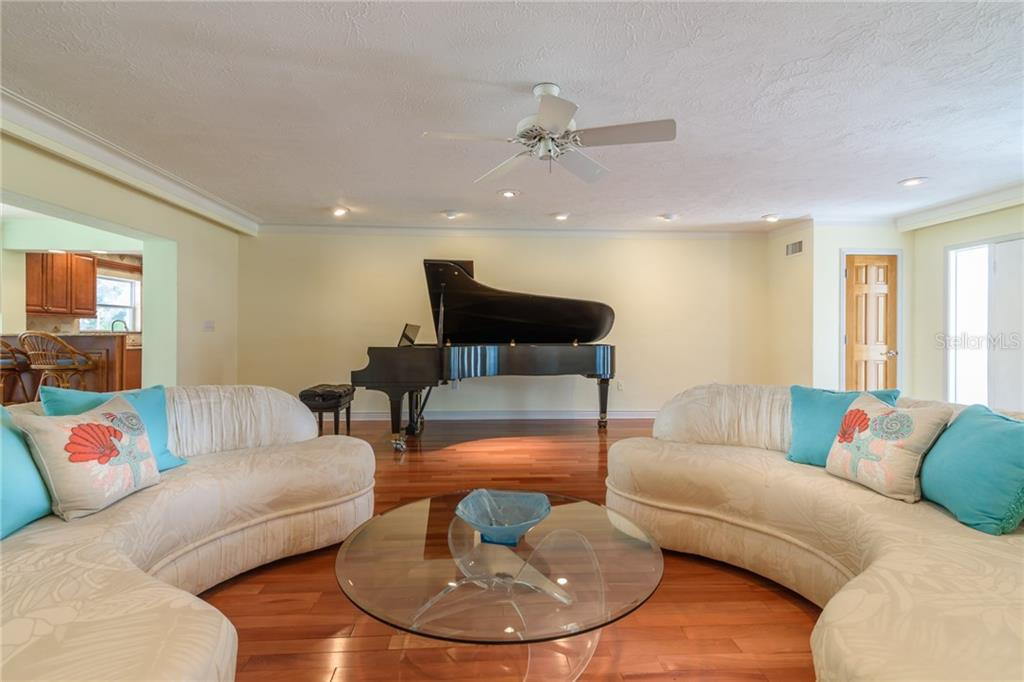 Living room - Single Family Home for sale at 5439 Azure Way, Sarasota, FL 34242 - MLS Number is A4203969