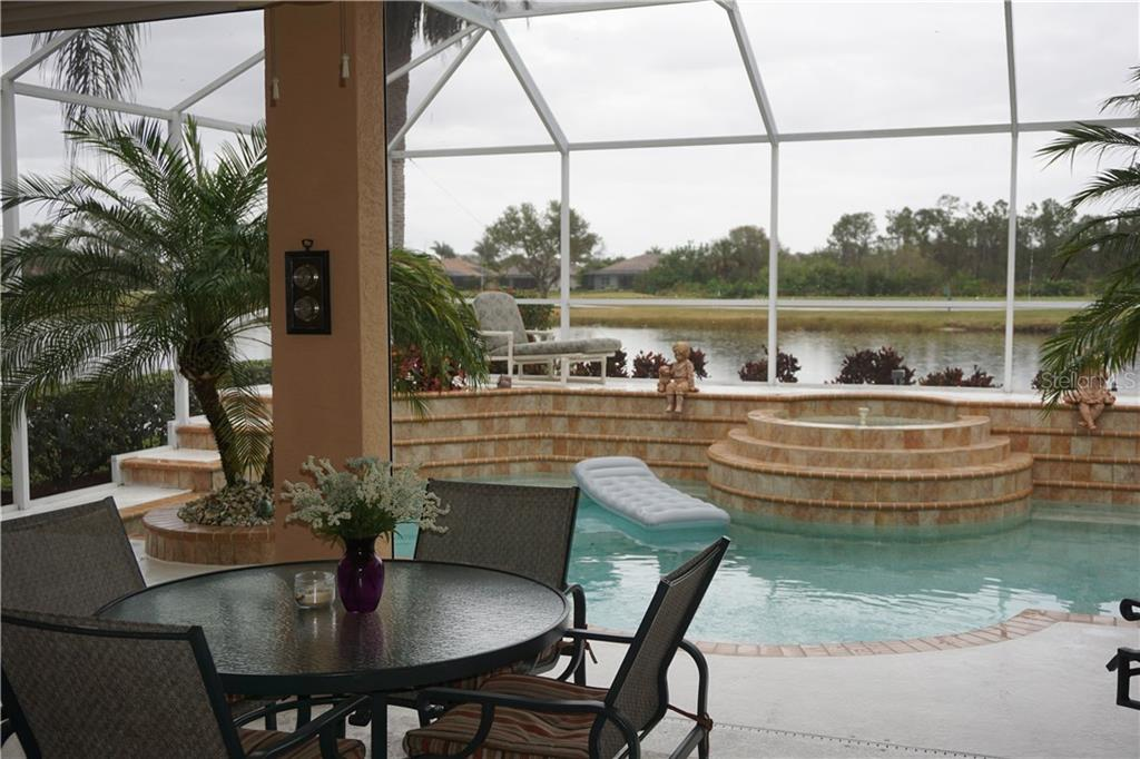 Covered lanai overlooking swimming pool out to lake view - Single Family Home for sale at 508 Marsh Creek Rd, Venice, FL 34292 - MLS Number is A4204933