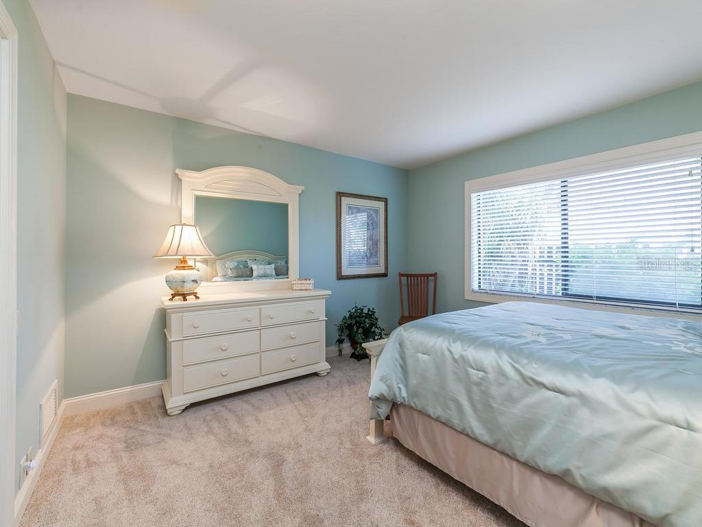 Bedroom #3, with one large beautiful window - Single Family Home for sale at 3959 Prairie Dunes Dr, Sarasota, FL 34238 - MLS Number is A4205907