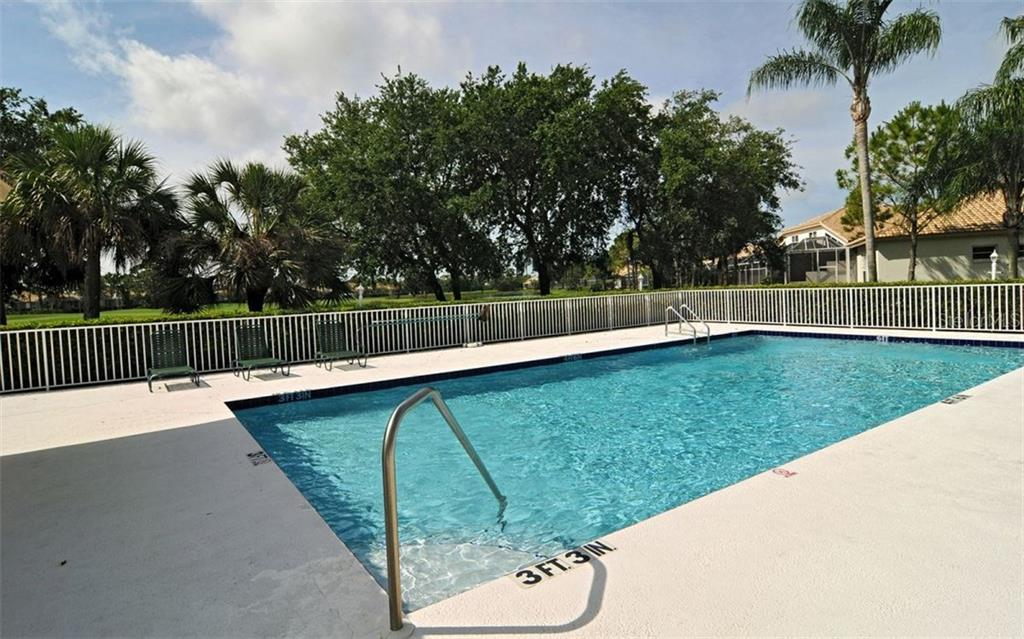 Forest Hills community heated pool and gathering spot. Newly resurfaced and stone pavers installed. Just a short stroll from this villa. - Villa for sale at 9554 Forest Hills Cir, Sarasota, FL 34238 - MLS Number is A4206506