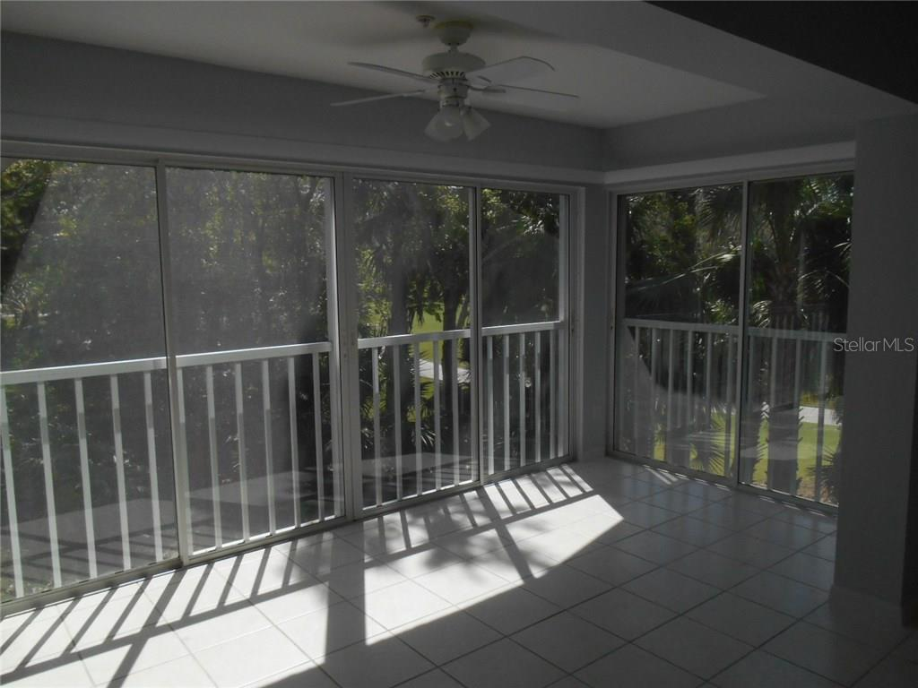 This bright dining area off of the kitchen is wonderfully versatile!  The sliding glass doors open to screens for a fantastic cross-breeze!  The current owner had a dining table with 6 chairs and this room could easily seat 8+!  Look at the views here! - Condo for sale at 815 Montrose Dr #202, Venice, FL 34293 - MLS Number is A4206556