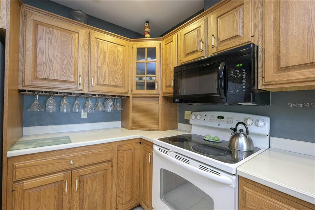 Plenty of storage in this kitchen. - Single Family Home for sale at 5633 Cape Leyte Dr, Sarasota, FL 34242 - MLS Number is A4207008
