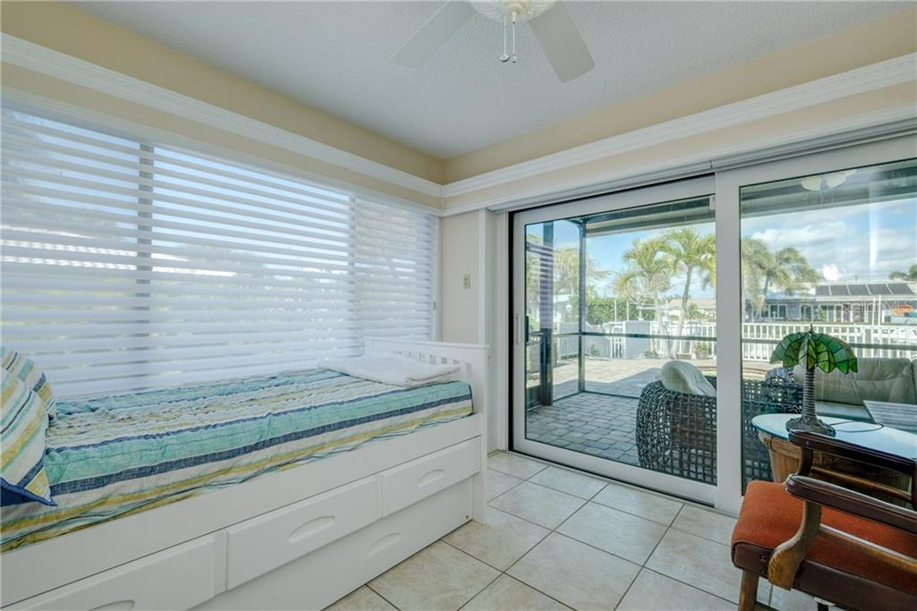 Studio looking to the lanai and pool. - Single Family Home for sale at 5633 Cape Leyte Dr, Sarasota, FL 34242 - MLS Number is A4207008