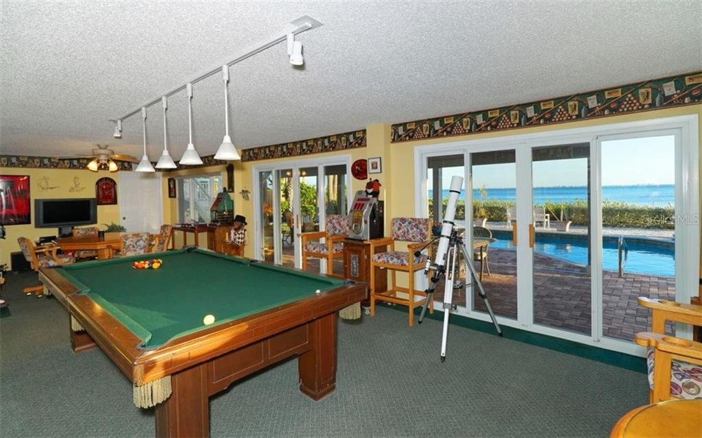Downstairs game room. - Single Family Home for sale at 3908 Bayside Dr, Bradenton, FL 34210 - MLS Number is A4207355