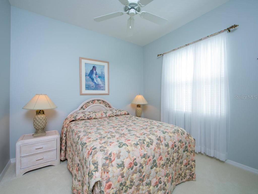Bedroom 2 - Single Family Home for sale at 1010 Oak Preserve Ln, Osprey, FL 34229 - MLS Number is A4207598
