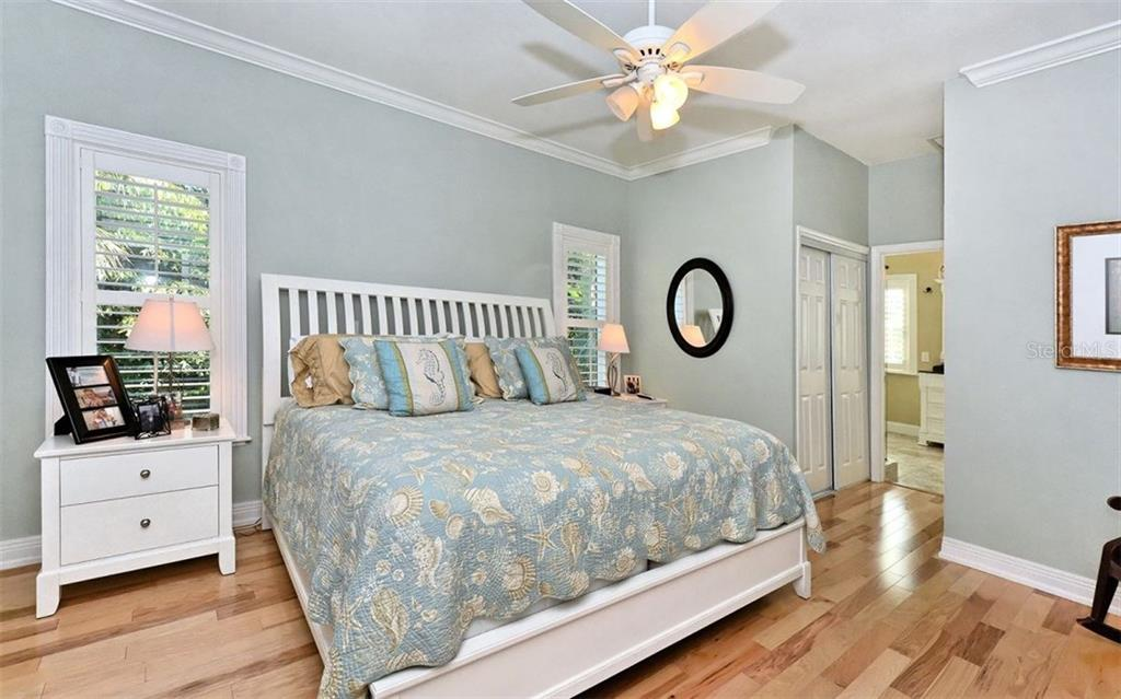 Master bedroom with en suite bathroom - Single Family Home for sale at 141 Ogden St, Sarasota, FL 34242 - MLS Number is A4208039