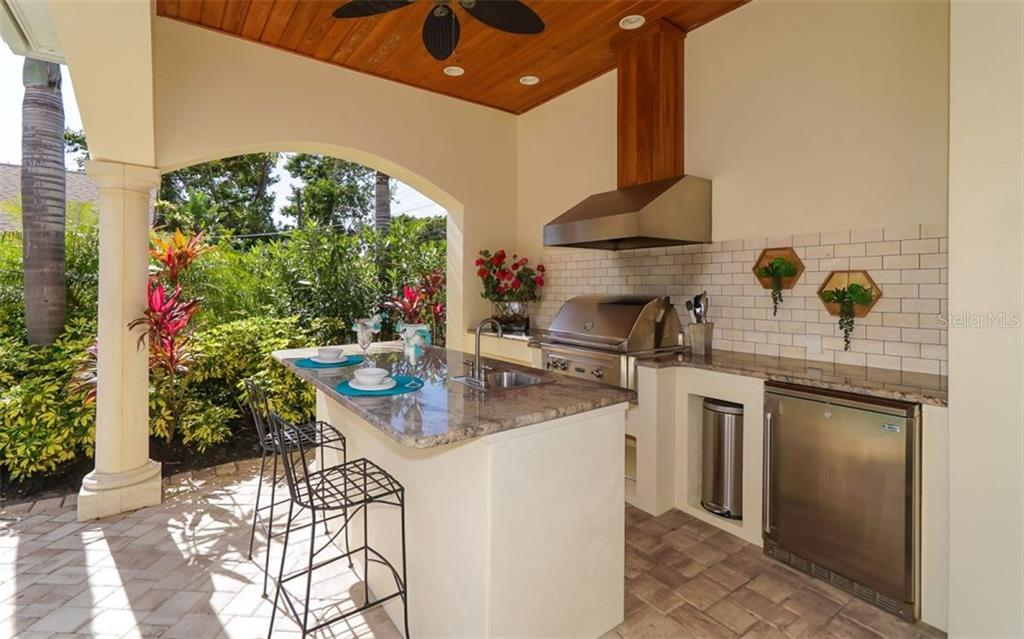 Amazing backyard entertaining area with Lynx grill - Single Family Home for sale at 1179 Morningside Pl, Sarasota, FL 34236 - MLS Number is A4209174