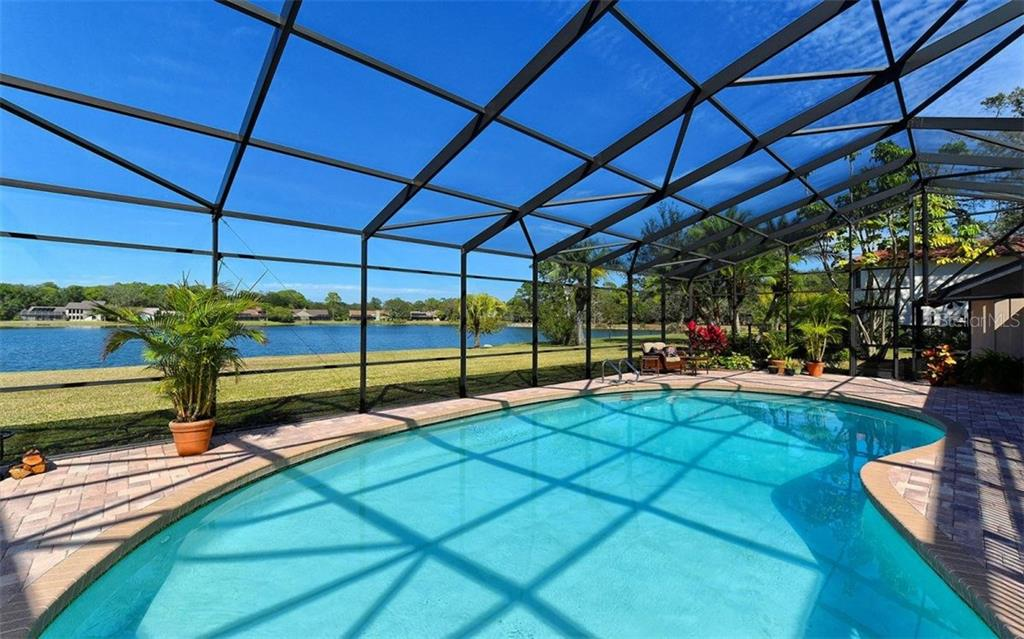 Breathtaking panoramic lake views. - Single Family Home for sale at 5122 Willow Leaf Dr, Sarasota, FL 34241 - MLS Number is A4209555