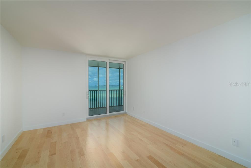 Master bedroom with sliders to screened terrace - Condo for sale at 4822 Ocean Blvd #11d, Sarasota, FL 34242 - MLS Number is A4209955