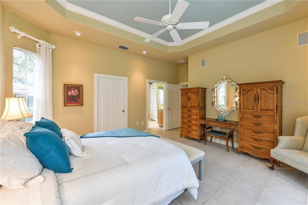 You'll also find recessed lighting and a beautiful tray ceiling. - Single Family Home for sale at 5585 Siesta Estates Ct, Sarasota, FL 34242 - MLS Number is A4211109