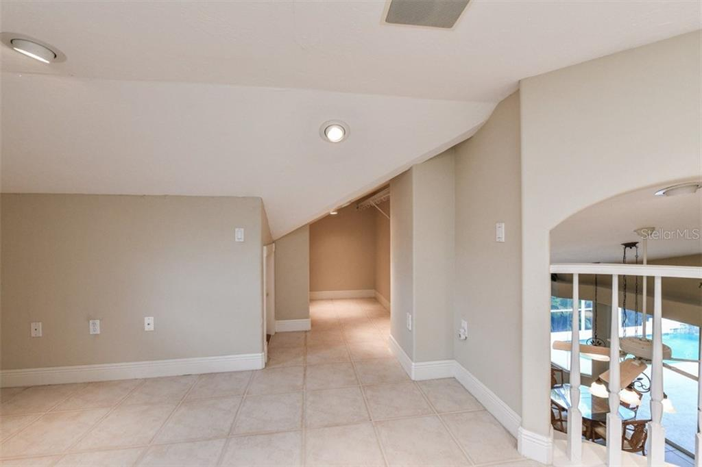 This wonderful BONUS space upstairs across from Bedroom #3 could be an office, artist's studio, playroom, reading room, or music room. - Single Family Home for sale at 5585 Siesta Estates Ct, Sarasota, FL 34242 - MLS Number is A4211109