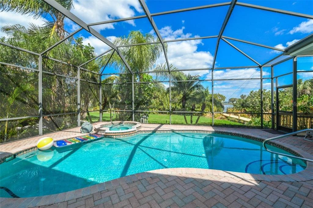 Single Family Home for sale at 1736 Amberwynd Cir W, Palmetto, FL 34221 - MLS Number is A4212012