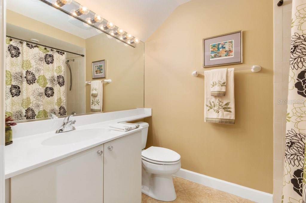 Guest or Second Bath with a tub and shower. - Condo for sale at 7504 Botanica Pkwy #101, Sarasota, FL 34238 - MLS Number is A4213208