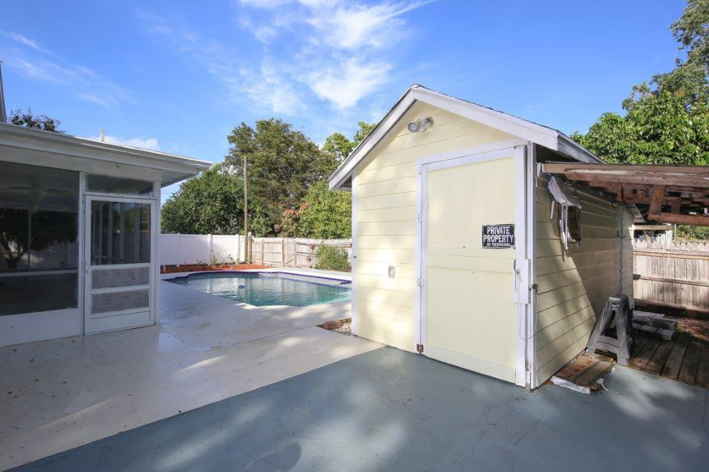 Park your cars in the garage!  Utilize the shed for storage or a workshop. - Single Family Home for sale at 4417 Garcia Ave, Sarasota, FL 34233 - MLS Number is A4213473