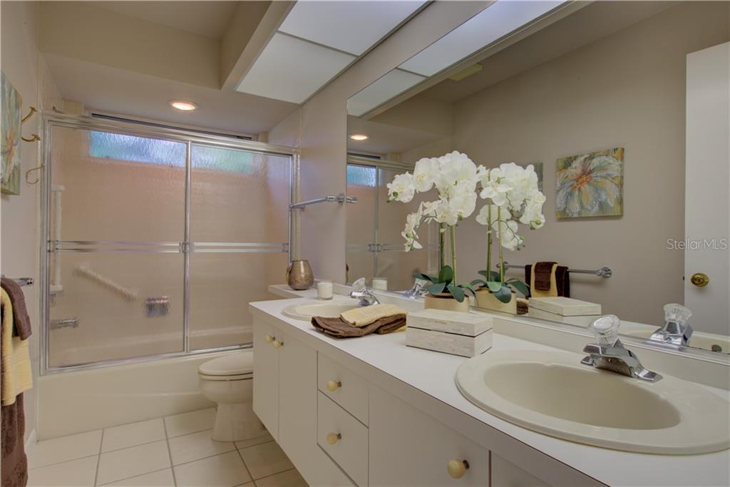 Guest bathroom with dual vanities - Single Family Home for sale at 3896 Boca Pointe Dr, Sarasota, FL 34238 - MLS Number is A4213831