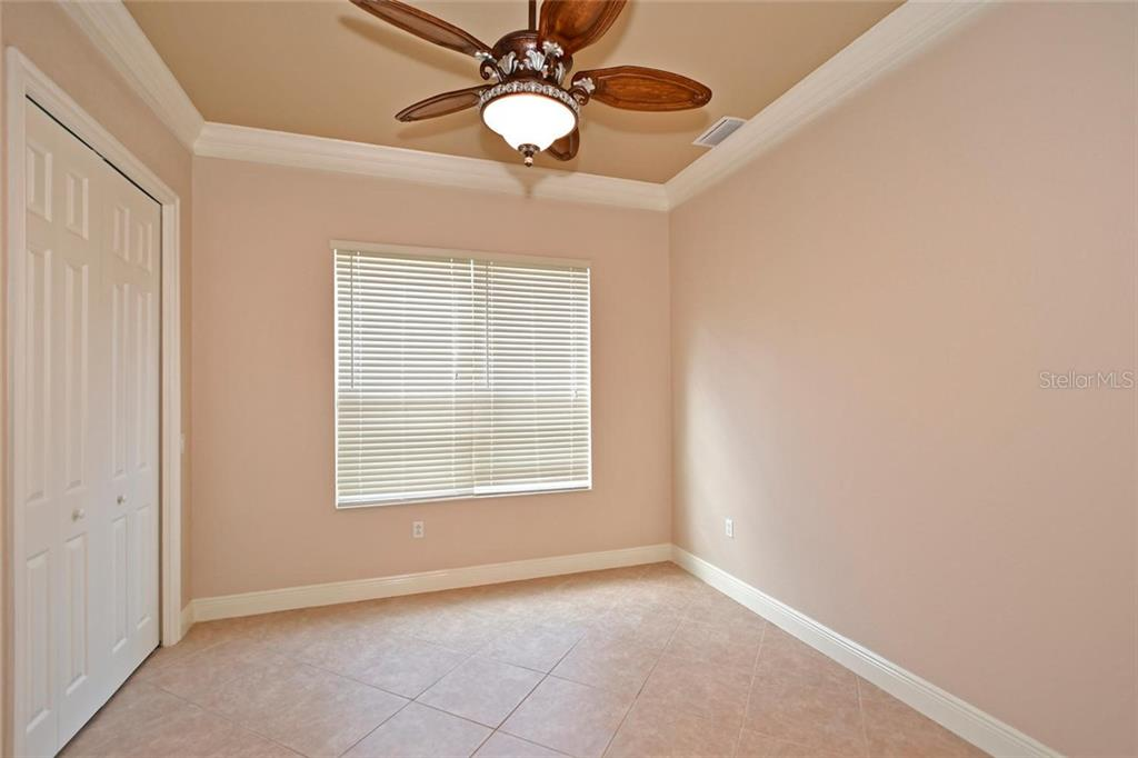 Den or can be used as a fifth bedroom.  When you visit be sure to open the closet door and you will see the extensive built-ins that maximize storage. - Single Family Home for sale at 3729 Summerwind Cir, Bradenton, FL 34209 - MLS Number is A4215992