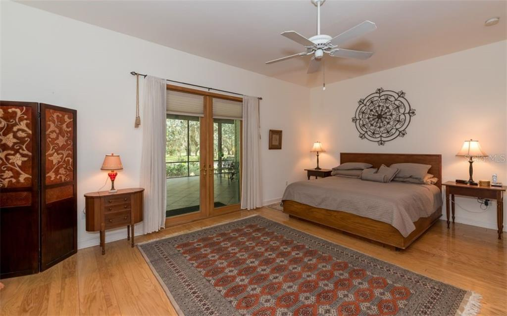Main House Master Bedroom - Single Family Home for sale at 7865 27th St E, Sarasota, FL 34243 - MLS Number is A4400492