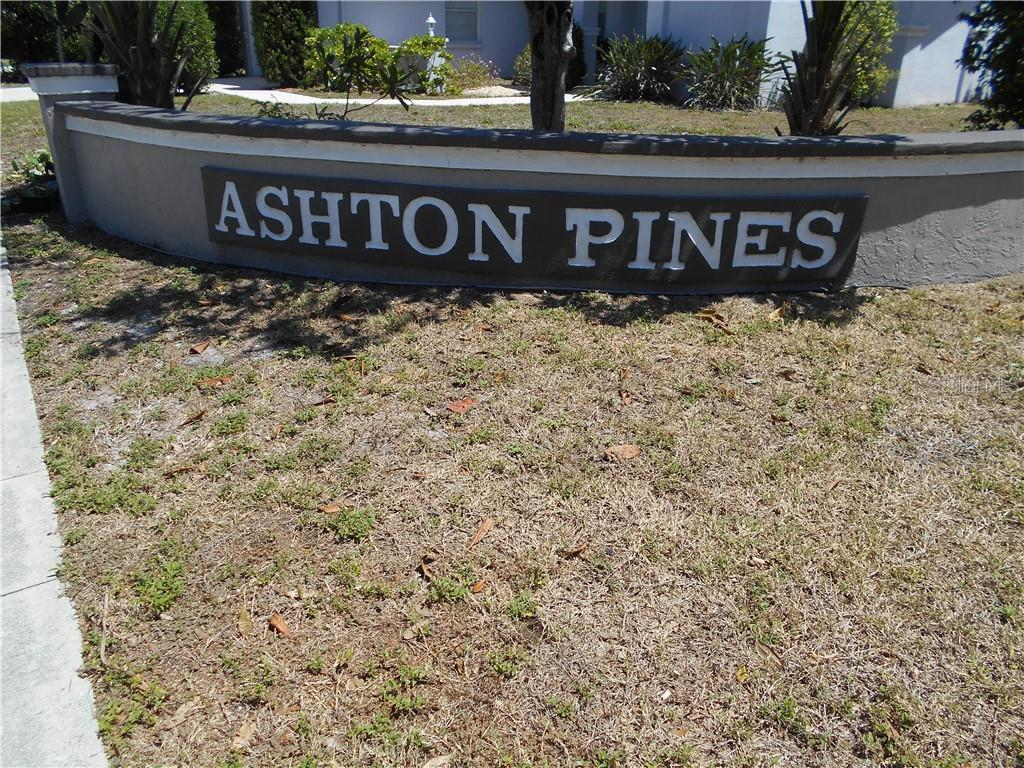 Community entrance - Single Family Home for sale at 5150 Ashton Pines Ln, Sarasota, FL 34231 - MLS Number is A4400646