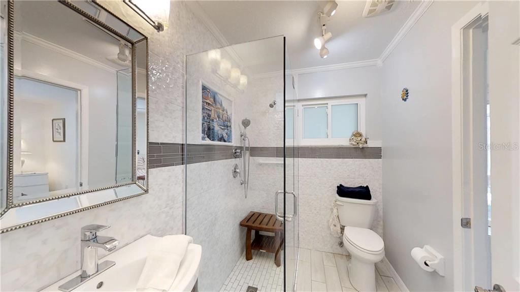 Master bath - Aquarium shower, moziac plus windows - Single Family Home for sale at 9011 Kingston Rd, Bradenton, FL 34210 - MLS Number is A4402527